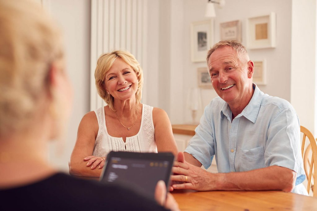 Retired couple discussing age pension with financial planner in Perth